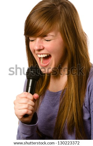 Screaming - This is a photo of a cute young adult screaming into a microphone. Shot on an isolated white background.