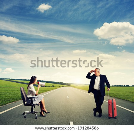 screaming woman and senior man with suitcase at outdoor