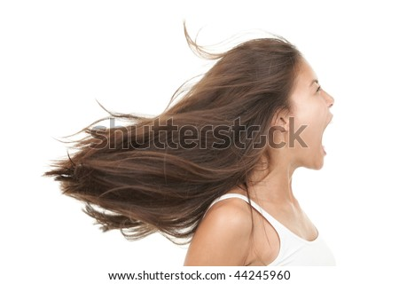 Screaming woman. Angry and upset beautiful young mixed race chinese / caucasian woman in profile. Isolated on white background - stock photo