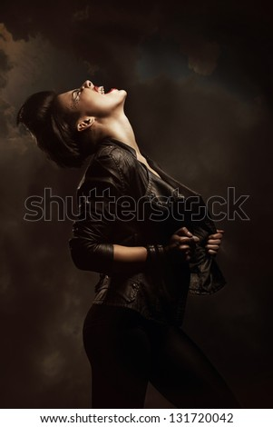 screaming woman in jacket - stock photo
