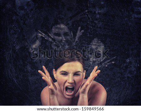 Screaming woman over dark background - stock photo