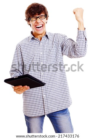 Screaming young man with raised fist and tablet computer in right hand isolated on white background - stock photo