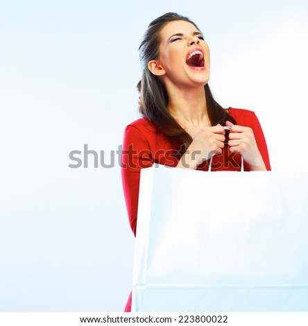 screaming young woman with closed eyes holding white shopping bag with copy space for advertising sign. white background isolated.