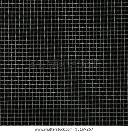 Screen door detail pattern against dark background. - stock photo