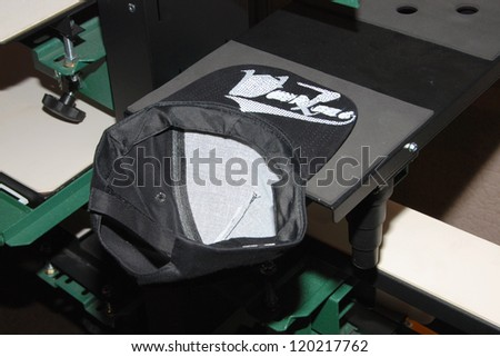Screen printing of hat with visor - stock photo