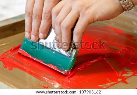 screen printing t shirts on print device - stock photo