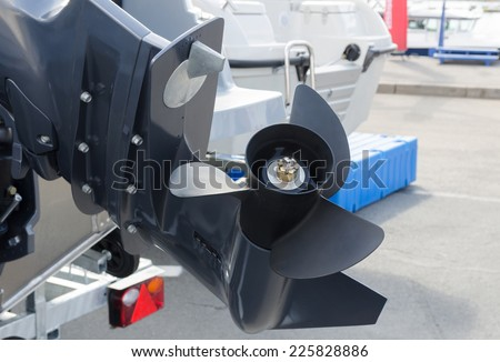 screw motor boat on the stocks on the beach - stock photo