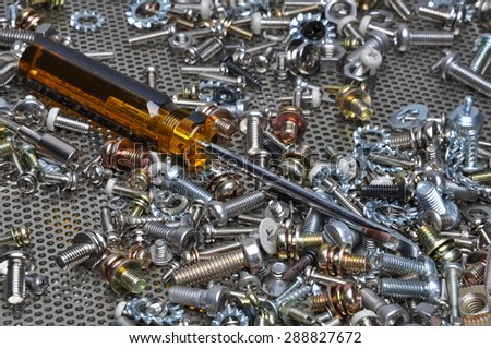 Screwdriver and components bolts, nuts, washers, screw