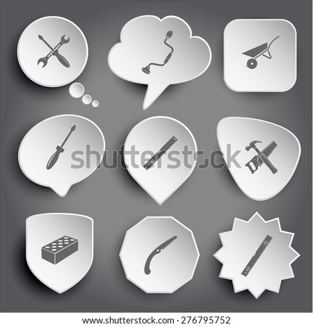 screwdriver and spanner, hand drill, wheelbarrow, spirit level, hand saw and hammer, hollow brick. White raster buttons on gray. - stock photo