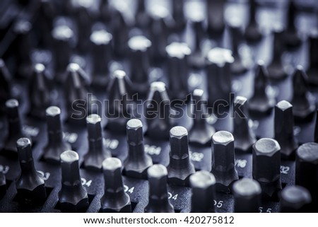 Screwdriver bits in close up. Toolkit set for diy work and repair. Group of industry hardware objects.  - stock photo