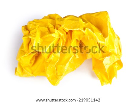Screwed up piece of yellow paper isolated on white background - stock photo