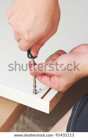 Screwing on a board - stock photo