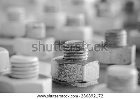 Screws and nuts on a Bridge -Weathered bolts on a steel beam, part of a railroad bridge in black and white - stock photo