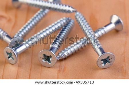 Screws on a piece of wood