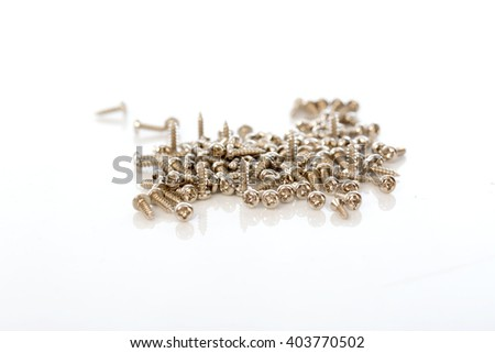Screws  on white background, selective focus