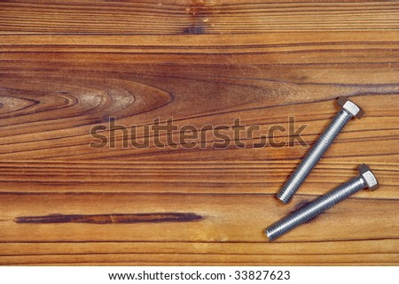 Screws on wood board. Background pic with screw at the right. Space for your text on the left.