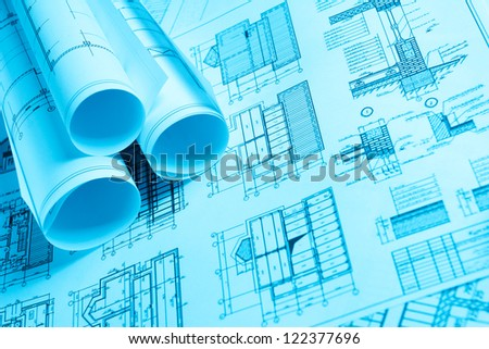 scrolls of technology blueprint on the house plan - stock photo