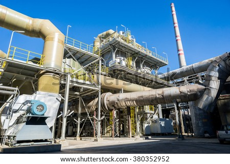 Scrubbers, acid tank and pipeline system, part of the industrail process in a smelter, foundry factory AURUBIS, Pirdop, Bulgaria, November 05, 2015. - stock photo