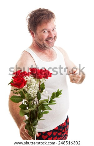 Scruffy unshaven husband in his underwear with red roses for Valentines Day.  Isolated on white.   - stock photo