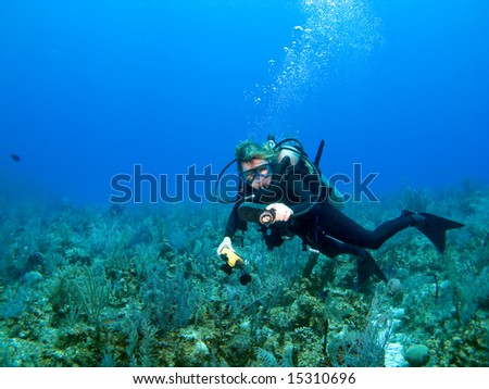 Scuba Diver Checking Gauges in the Caribbean - stock photo