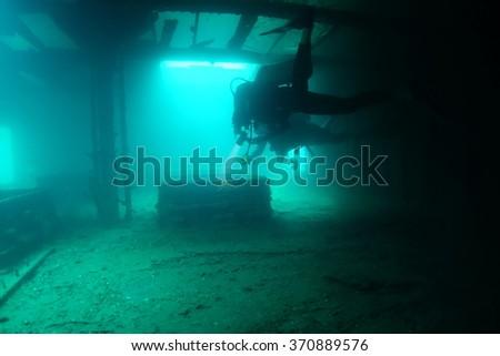 Scuba diver in a shipwreck - stock photo
