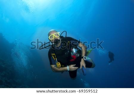 scuba diver in blue water - stock photo