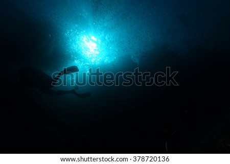 Scuba diver in ocean - stock photo