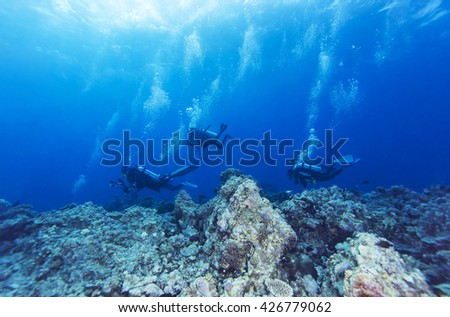 Scuba diver in tropical coral reef. - stock photo
