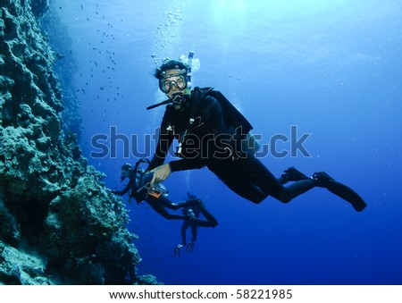 scuba diver on reef - stock photo