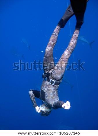 Scuba diver swim in the ocean - stock photo