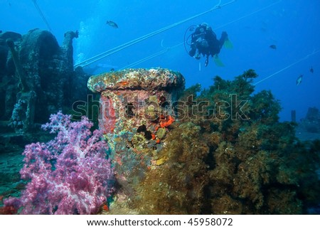 Scuba Diver with Camera and Wreck - stock photo
