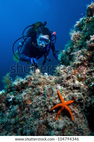 Scuba diver with red starfish
