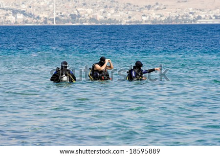Scuba divers on a Red Sea - stock photo