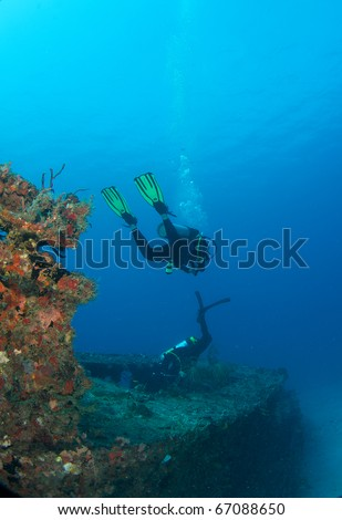 Scuba divers on an artificial reef ship wreck in south east Florida. - stock photo
