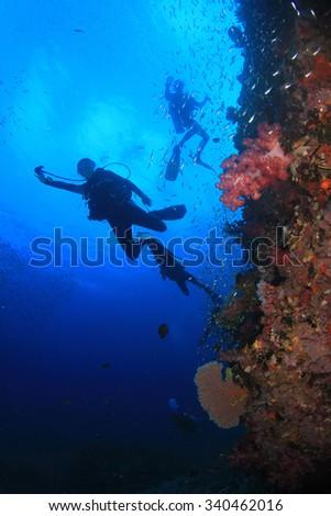 Scuba diving coral reef underwater ocean - stock photo