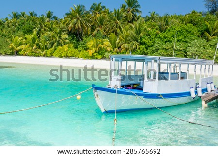 scuba diving excursion boat docked at the pier in Maldives - stock photo