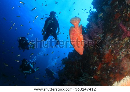 Scuba diving on coral reef with tropical fish in Thailand - stock photo