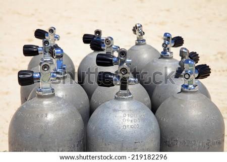 Scuba tanks on the beach  - stock photo