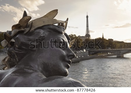 Sculpture in the Alexander III bridge over the Seine river in Paris, France - stock photo