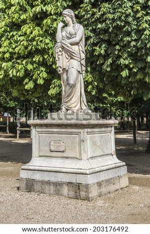 Sculpture in Tuileries garden Paris. The Tuileries is a public garden located between the Louvre Museum and the Place de la Concorde. France. - stock photo