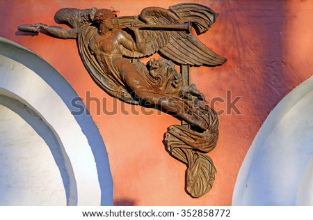 Sculpture of an angel on the wall of the Donskoi monastery in Moscow - stock photo