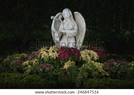 Sculpture of angel in dark - stock photo