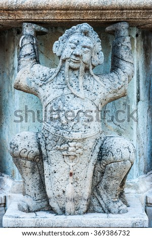 Sculpture of chinese person ,Antique stone carving doll in ancient temple.