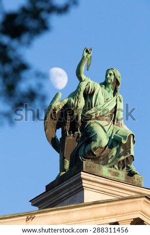 Sculpture of Evangelist John with an eagle by sculptor Ivan Petrovich Vitali (1794-1855), on the Isaac cathedral, St Petersburg  - stock photo