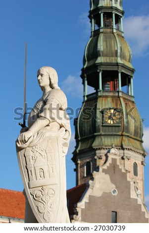 Sculpture of Roland and St. Peter's Cathedral (Town Hall square, Riga, Latvia). - stock photo