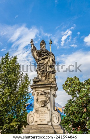 Sculpture of Saint Augustine on the Charles Bridge in Prague. Czech Republic. - stock photo
