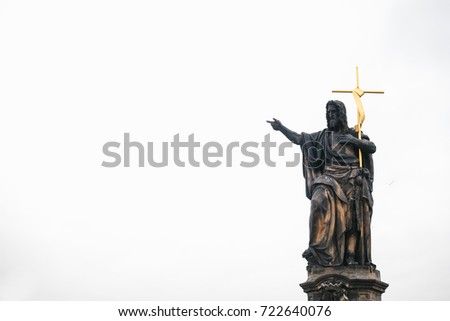 Sculpture of St. John the Baptist. One of the ancient statues on the Charles Bridge in Prague in the Czech Republic. European old architecture.
