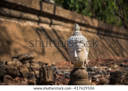 Sculpture of Stone Buddha in Wat U-mong (U-mong temple), an ancient temple in Chiang Mai, Thailand. - stock photo