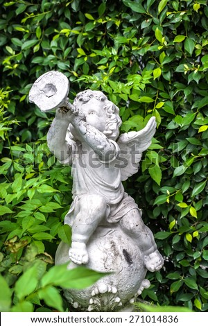Sculpture of Stone Cupid with Trumpet, Roman Style - stock photo