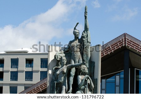 Sculpture of the Maori explorer that found New Zealand,Kupe, on Wellington Waterfront New Zealand. - stock photo